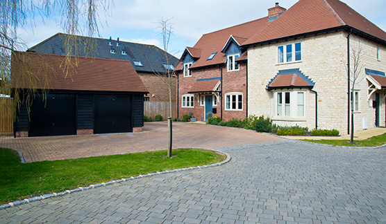 surfacing specialists using dropped kerb tarmac finish leading to a block driveway